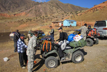 Quad off road adventure tour through the high mountain range of the Tian Shan